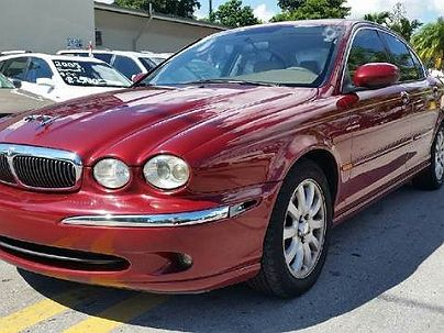 Photo 1: Burgundy 2002 Jaguar X-Type in Hollywood, FL exterior view from front driver's side