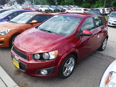 Photo 1: Crystal Red Tintcoat 2014 Chevrolet Sonic LTZ in South Burlington, VT exterior view from front driver's side