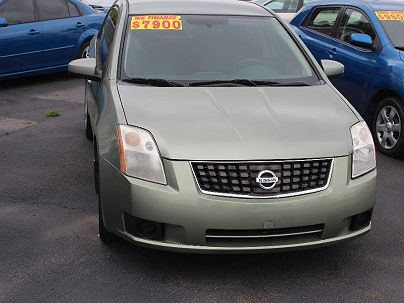 Photo 1: Light Green 2007 Nissan Sentra in Augusta, GA front view of grill, headlights, hood and windshield
