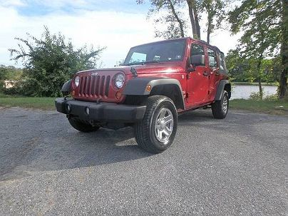 Photo 1: Burgundy 2011 Jeep Wrangler Sport in Smyrna, DE exterior view from rear passenger side