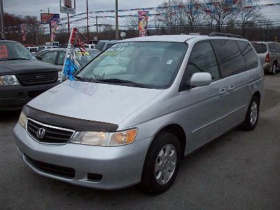 Photo 1:  2002 Honda Odyssey EX in Moody, AL front view of grill, headlights, hood and windshield
