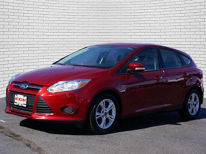 Photo 1: Ruby Red Metallic Tinted Clear Coat 2013 Ford Focus SE in Wichita, KS