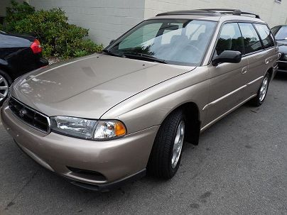 Photo 1: Sandstone Metallic 1999 Subaru Legacy L in Pound Ridge, NY exterior view from front driver's side
