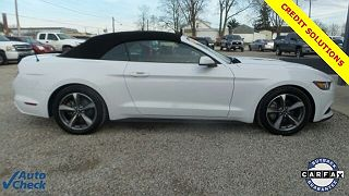 Photo 1: Oxford White 2015 Ford Mustang in  exterior view of passenger side