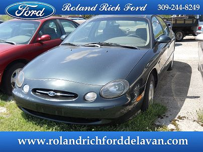 Photo 1: Spruce Green Metallic 1999 Ford Taurus SE in Delavan, IL exterior view from front driver's side