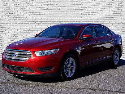 Photo 1: Ruby Red Metallic Tinted Clear Coat 2014 Ford Taurus SEL in Wichita, KS