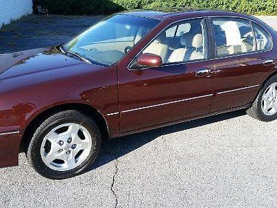 Photo 1: Burgundy 1999 Infiniti I30 in Macon, GA front view of grill, headlights, hood and windshield
