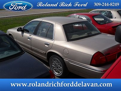 Photo 1: Arizona Beige Metallic 2001 Mercury Grand Marquis LS in Delavan, IL exterior view from rear passenger side