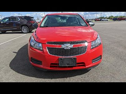 Photo 1: Red Hot 2014 Chevrolet Cruze LS in Shelby, OH exterior view of driver's side