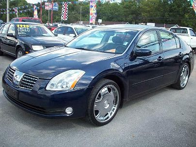 Photo 1:  2004 Nissan Maxima SL in Moody, AL front view of grill, headlights, hood and windshield