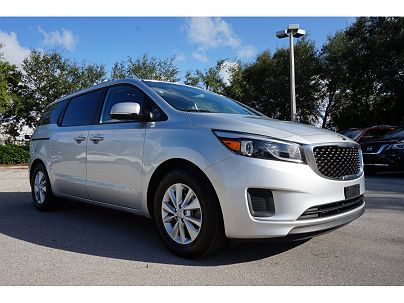 Photo 1: Bright Silver 2015 Kia Sedona LX in North Palm Beach, FL exterior view from front driver's side