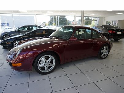Photo 1: Arena Red Metallic 1996 Porsche 911 Carrera 4 in San Mateo, CA exterior view from front driver's side