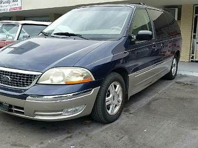 Photo 1:  2002 Ford Windstar SEL in Hollywood, FL exterior view from front driver's side