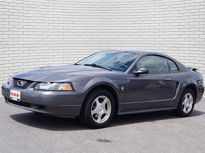 Photo 1: Dark Shadow Gray Clear Coat Metallic 2003 Ford Mustang in Wichita, KS exterior view of passenger side
