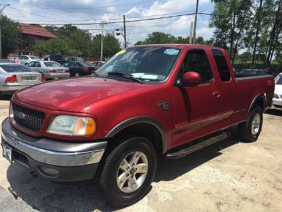 Photo 1: Maroon 2002 Ford F-150 XLT in Lanham, MD